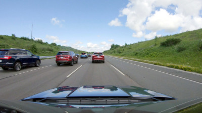 A view of the space between vehicles when vehicles are not using Ford's adaptive cruise control technology, relying instead on driver reactions to vehicle movements around them.