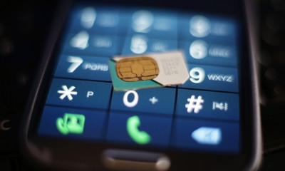 A view of a sim card and the keypad of a mobile phone, as the Government's spy agency GCHQ reportedly stole confidential codes from a Dutch Sim card manufacturer to hack into mobile phones around the world, the latest set of leaked intelligence documents suggest. PRESS ASSOCIATION Photo. Picture date: Friday February 20, 2015. See PA story POLITICS GCHQ. Photo credit should read: Yui Mok/PA Wire